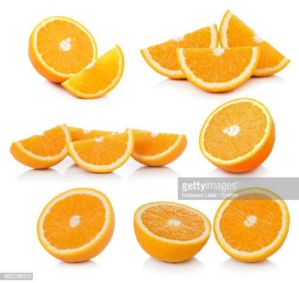 close-up of citrus fruits against white background - naranja fotografías e imágenes de stock