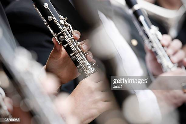 Close-up of clarinets playing in an orchestra with shallow DOF