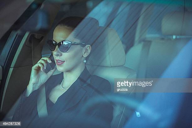 close-up of classy woman using mobile phone in the car - stereotypically upper class stock pictures, royalty-free photos & images