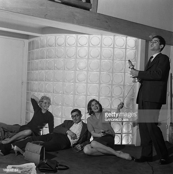 Close-Up Of Claude Chabrol. Claude CHABROL chez lui à Neuilly, dans l'appartement-atelier où il élabore ses films, avec une partie de l'équipe des...