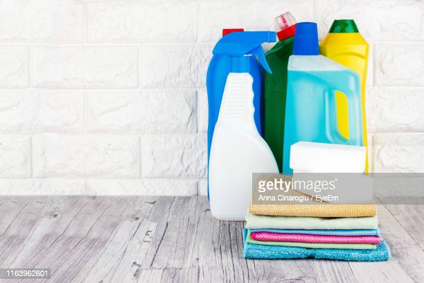 close-up of cleaning equipment on table against wall - cleaning agent stock pictures, royalty-free photos & images