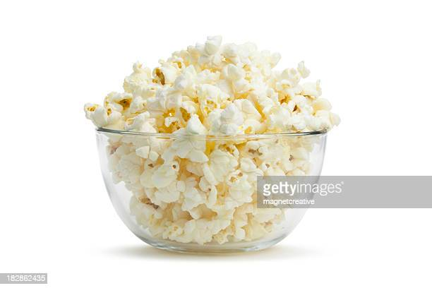 Close-up of clear bowl with freshly popped corn