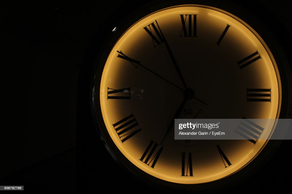 Close-Up Of Clock Against Black Background : Stock Photo
