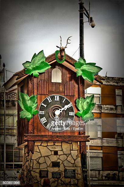 close-up of clock against clear sky - andres ruffo stock photos and pictures