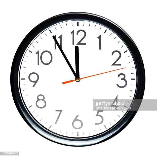 close-up of clock against white background - wall clock stock photos and pictures
