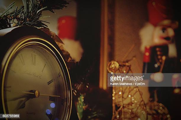 Close-Up Of Clock At Home During Christmas