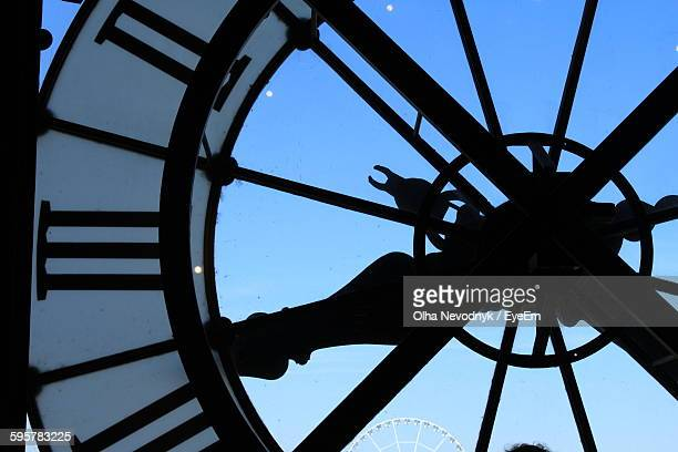 close-up of clock in tower against blue sky - clock tower stock pictures, royalty-free photos & images