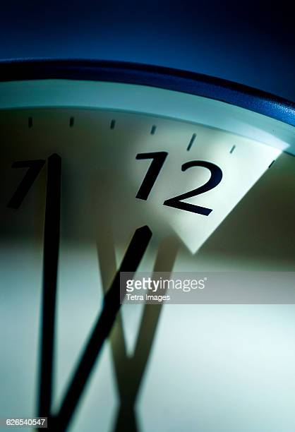Close-up of clock on blue background