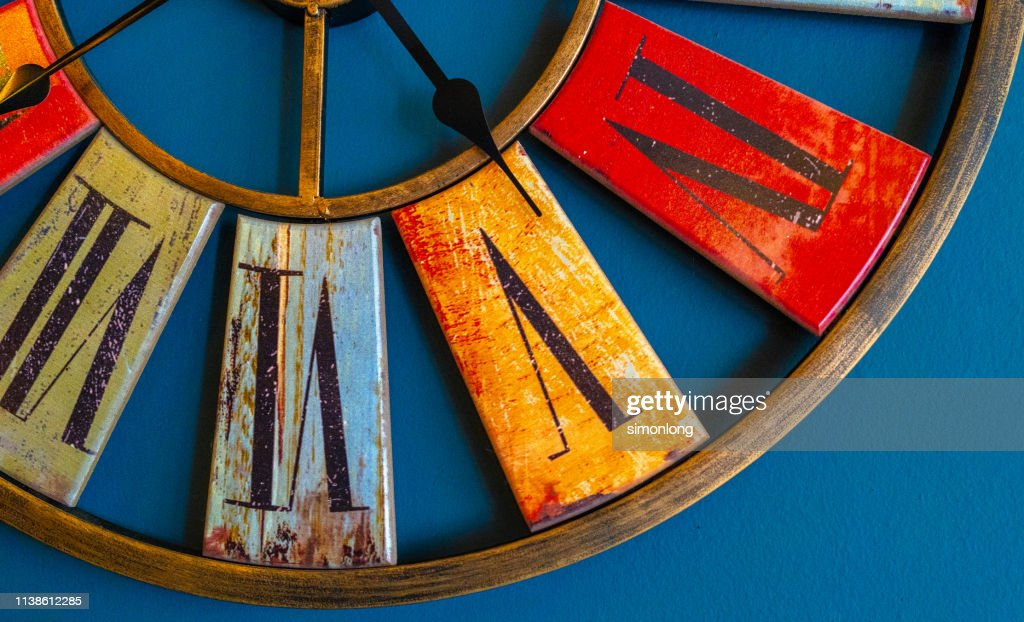 Close-up of clock on blue wall : Stock Photo