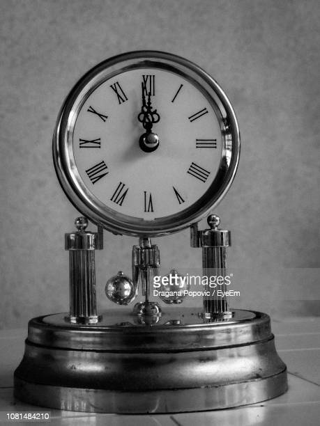 close-up of clock on table at home - cadran d'horloge photos et images de collection