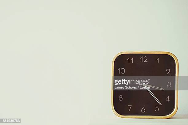 close-up of clock on the wall - wall clock stock photos and pictures