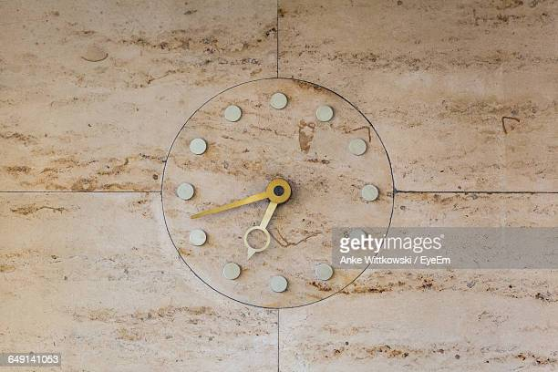 Close-Up Of Clock On Tiled Wall