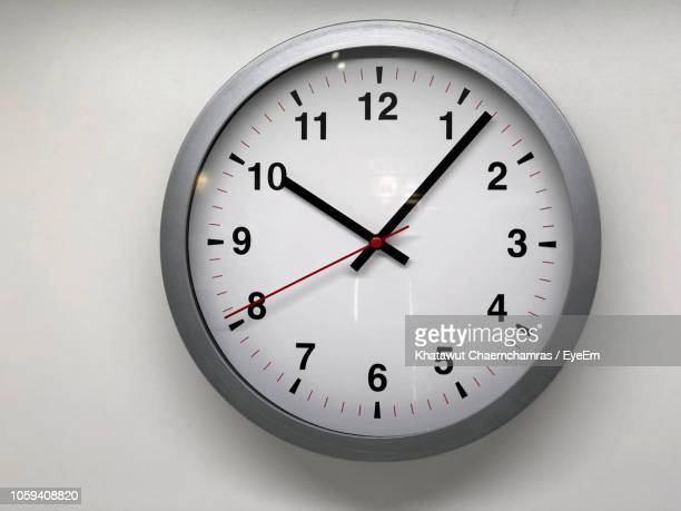 close-up of clock on wall - clock stock pictures, royalty-free photos & images