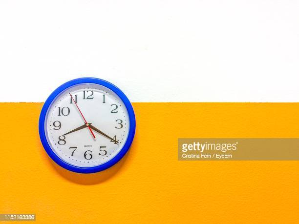 close-up of clock on wall - wall clock stock pictures, royalty-free photos & images