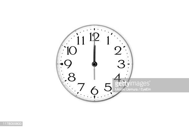close-up of clock on white background - wall clock stock pictures, royalty-free photos & images