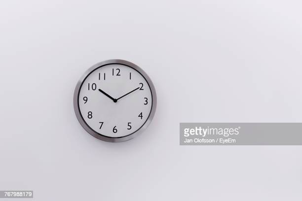 close-up of clock on white background - countdown clock stock-fotos und bilder