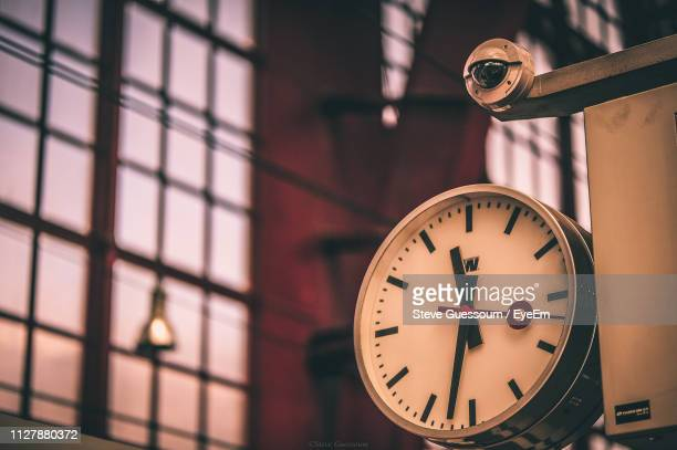 close-up of clock - steve guessoum stockfoto's en -beelden