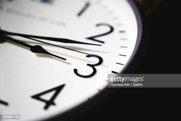 close-up of clock - clock stock pictures, royalty-free photos & images