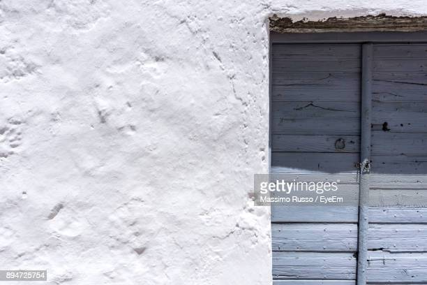 close-up of closed door on wall - whitewashed stock photos and pictures