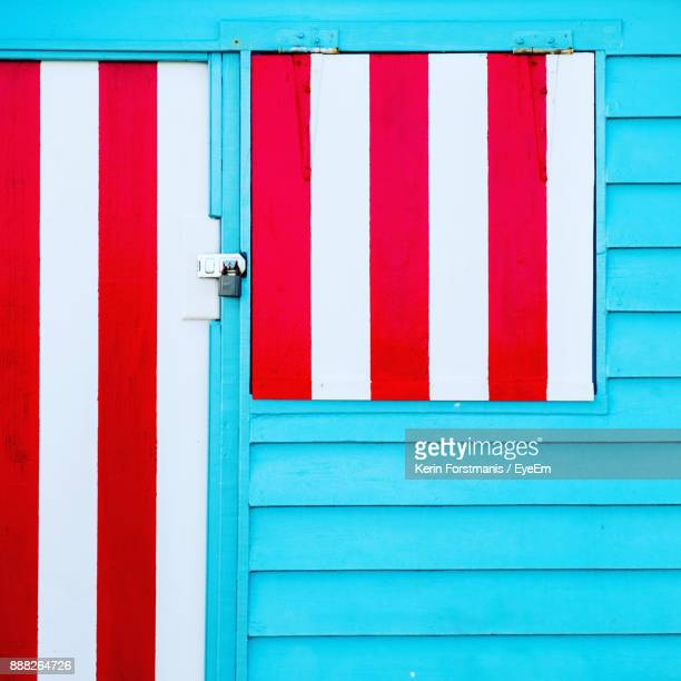 Close-Up Of Closed Red And Blue Door