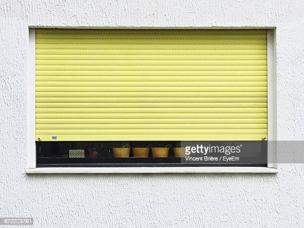Close-Up Of Closed Shutter On Window Of Store