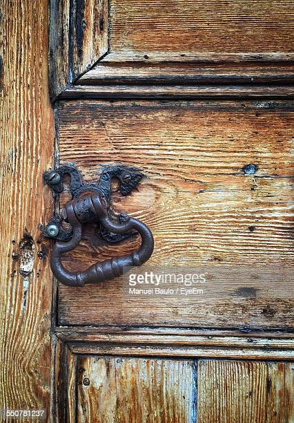 close-up of closed wooden door with knocker - lavenham stock photos and pictures