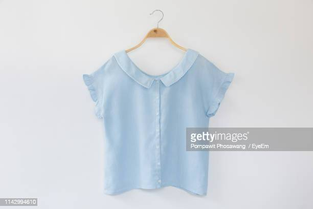 close-up of cloth hanging on white background - blouse imagens e fotografias de stock