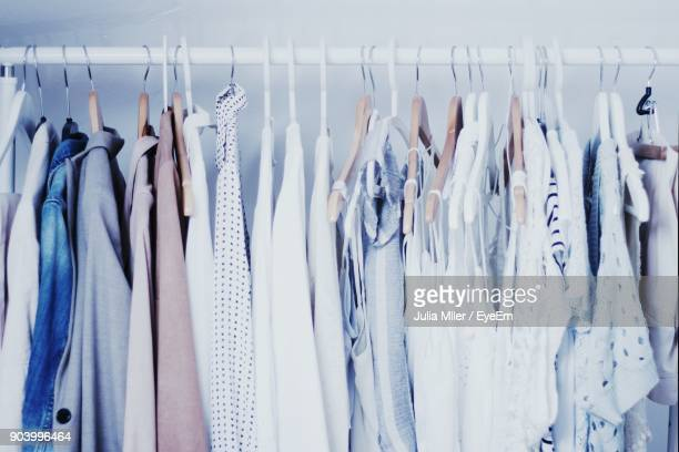 close-up of clothes hanging at home - womenswear stock pictures, royalty-free photos & images