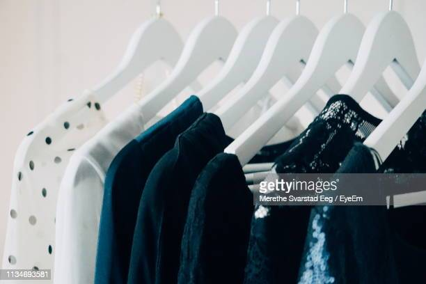 close-up of clothes hanging at store - rack stock pictures, royalty-free photos & images