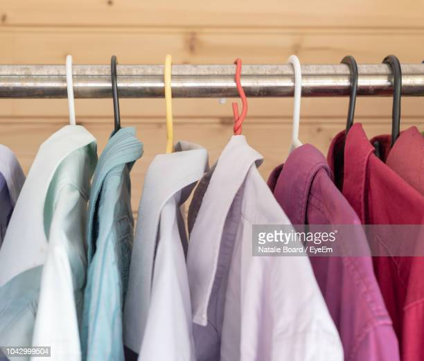 close-up of clothes hanging in rack - buntes hemd stock-fotos und bilder