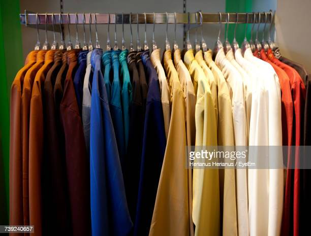 close-up of clothes hanging in row - clothes rack stock pictures, royalty-free photos & images