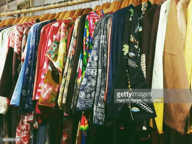 Close-Up Of Clothes Hanging In Store For Sale