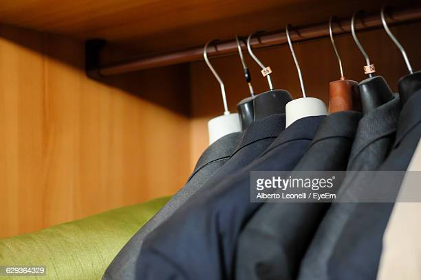 Close-Up Of Clothes Hanging On Coathanger In Wardrobe