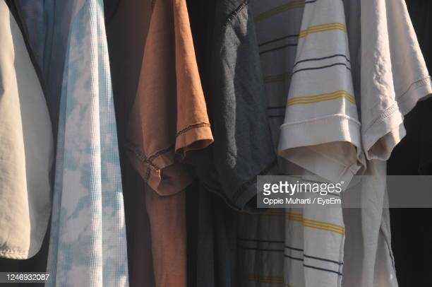 close-up of clothes hanging on curtain - menswear stock pictures, royalty-free photos & images