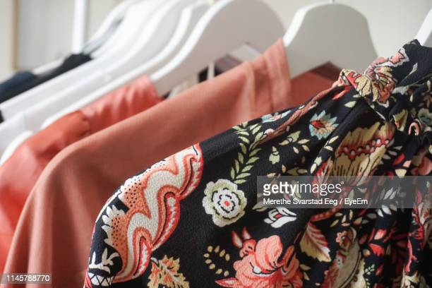 close-up of clothes hanging on display at store - vêtement pour femmes photos et images de collection