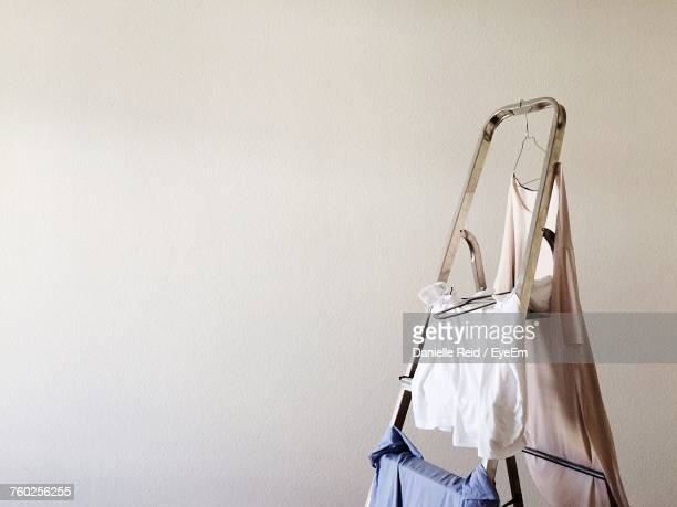 close-up of clothes hanging on ladder - danielle reid stock pictures, royalty-free photos & images