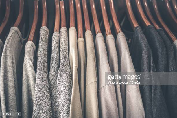 close-up of clothes hanging on rack at home - men fashion stock pictures, royalty-free photos & images