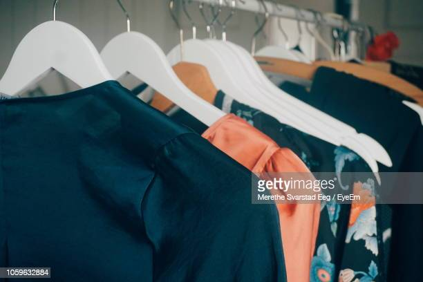 close-up of clothes hanging on rack in store - womenswear stock pictures, royalty-free photos & images