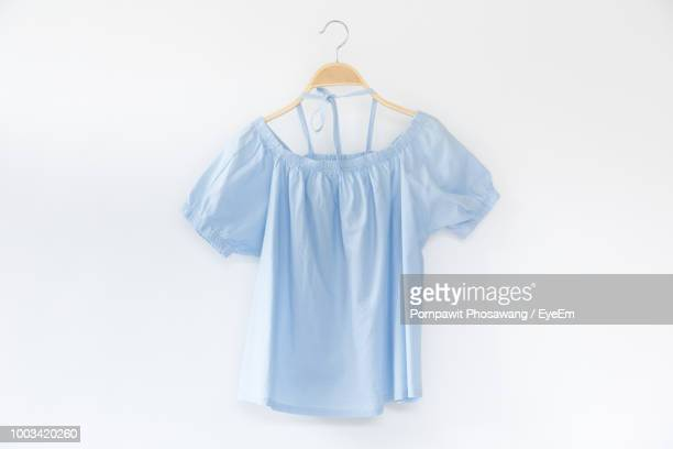 Close-Up Of Clothes Hanging Over White Background