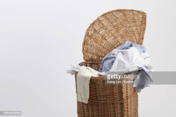 close-up of clothes in laundry basket against white background - 洗濯物 ストックフォトと画像
