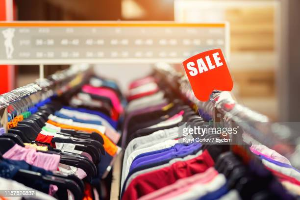 close-up of clothes in store for sale - sale stock pictures, royalty-free photos & images