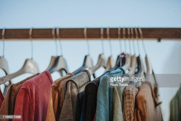 close-up of clothes on rack - vestido fotografías e imágenes de stock