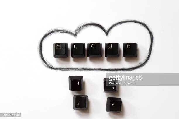 close-up of cloud drawing with computer keyboards against white background - datortangent bildbanksfoton och bilder