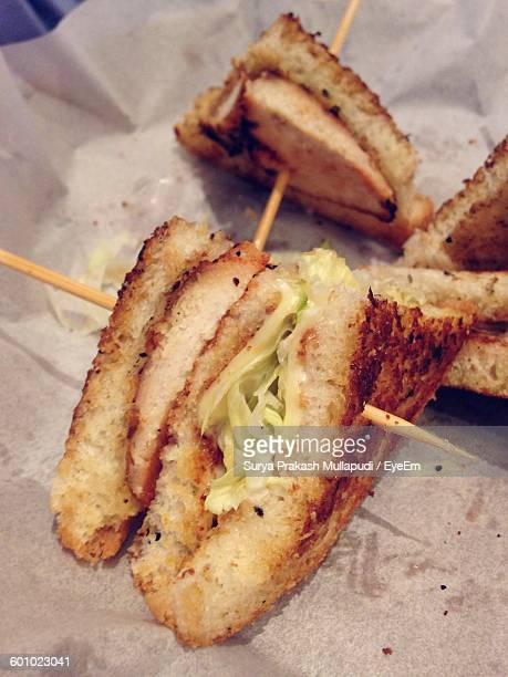 close-up of club sandwiches on paper - club sandwich stock pictures, royalty-free photos & images