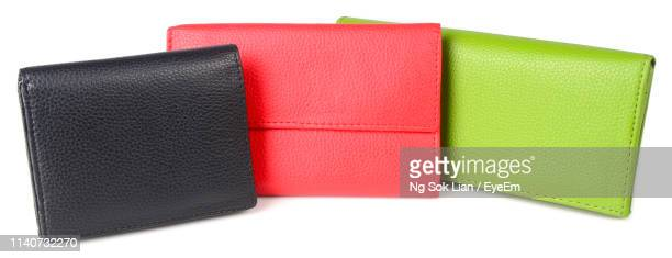 close-up of clutch bags against white background - red leather purse stock pictures, royalty-free photos & images