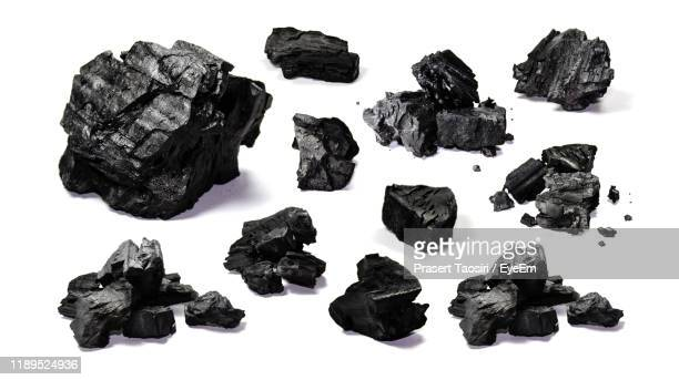 close-up of coals over white background - coal stock pictures, royalty-free photos & images