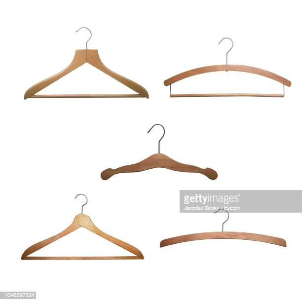 close-up of coathangers against white background - coathanger stock pictures, royalty-free photos & images