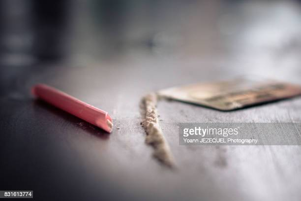 Close-Up Of Cocaine And Credit Card On Black Background