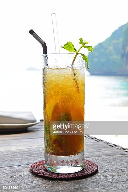 Close-Up Of Cocktail Against Calm Lake
