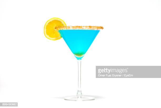 close-up of cocktail against white background - martini glass stock photos and pictures